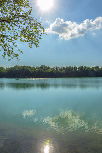 Forli, Italy, blue water lake with canoe in a sunny day Beauty In Nature Cloud - Sky Day Growth Lake Nature No People Non-urban Scene Outdoors Plant Reflection Scenics - Nature Sky Sunbeam Sunlight Tranquil Scene Tranquility Tree Water