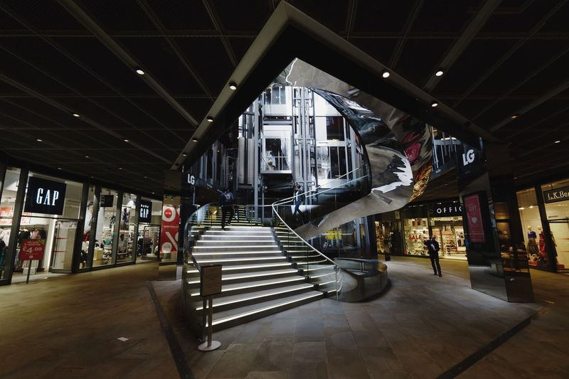 Architecture Built Structure Indoors  Text Incidental People Ceiling Communication Transportation Illuminated The Way Forward Lighting Equipment Day Travel City Architectural Column Sign Shopping Mall
