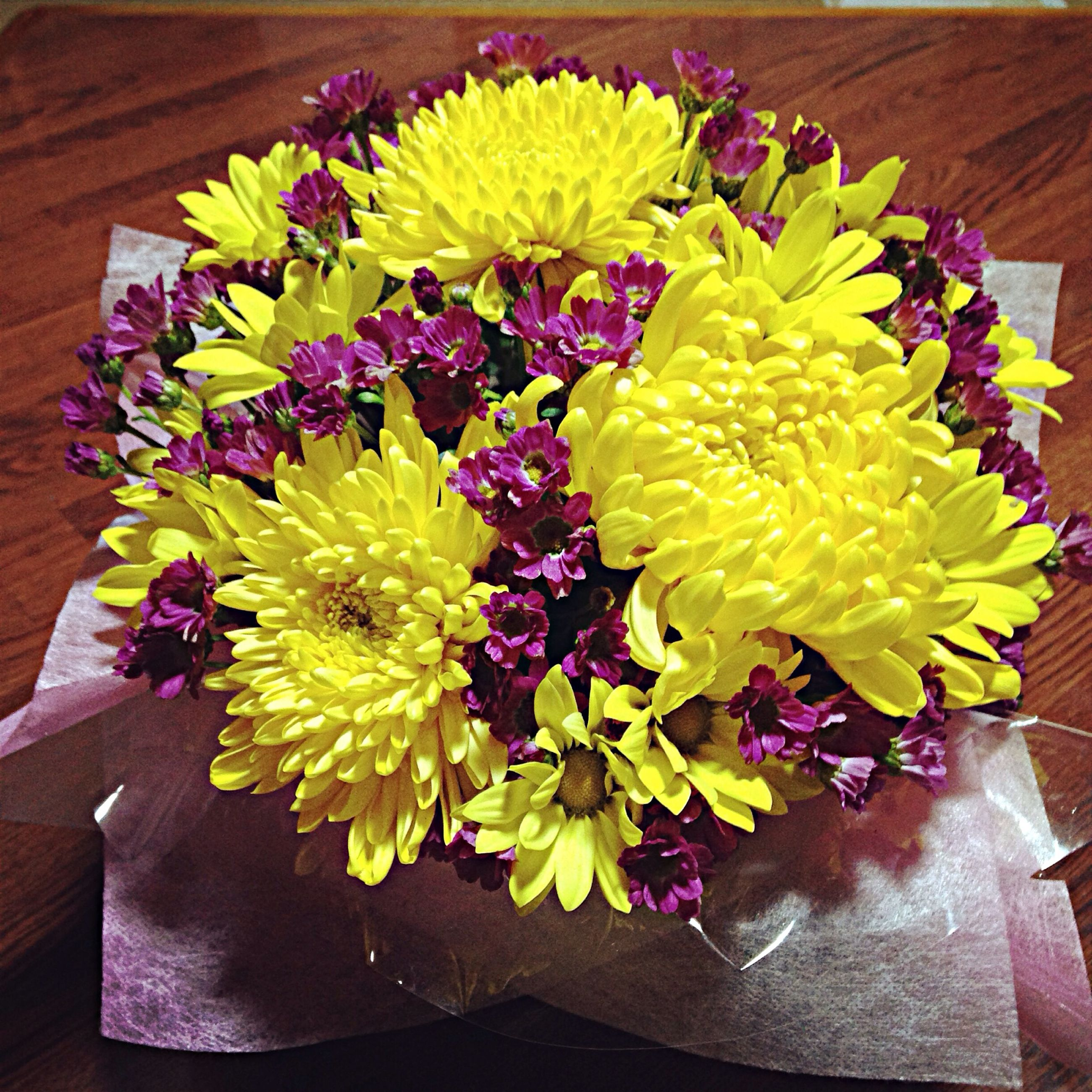 flower, yellow, fragility, freshness, flower head, petal, high angle view, nature, beauty in nature, gerbera daisy, indoors, close-up, multi colored, no people, flower arrangement, chrysanthemum, bouquet, dahlia, day
