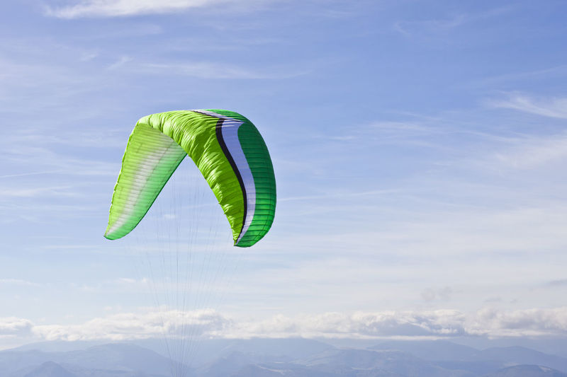 Low angle view of green flying in sky