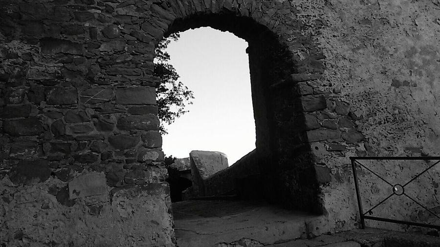 The Secret Spaces Arch Castle History Architecture Blackandwhite Photography TheMinimals (less Edit Juxt Photography) Monocrome Black And White Shadows & Lights Poetry & Photography Language The Beauty In Simplicity In Castiglione Della Pescaia Tuscany Italy Doors From The Past Stone Material Building Exterior Old Ruin Break The Mold The Graphic City