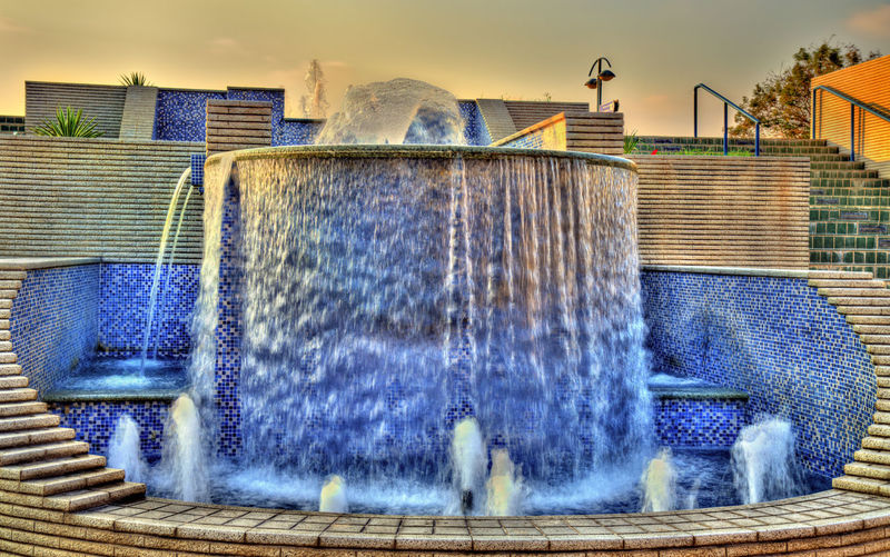 Water splashing on fountain against building