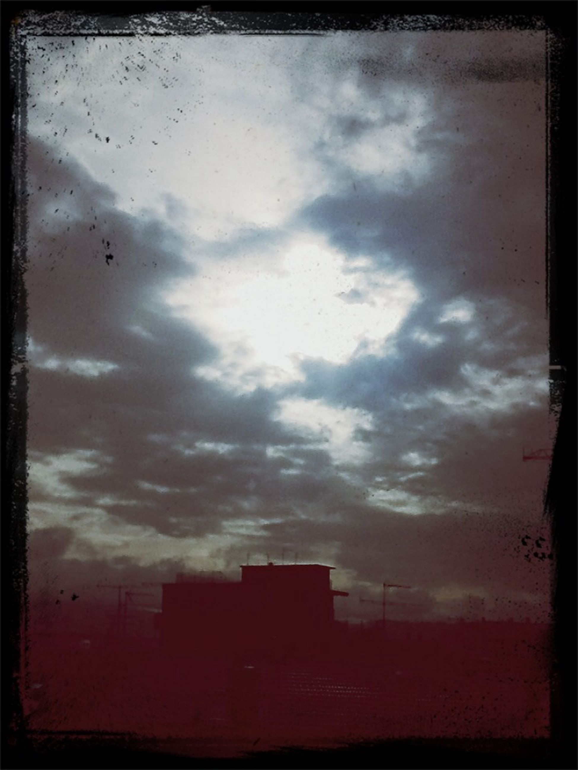 transfer print, sky, cloud - sky, auto post production filter, sunset, cloudy, silhouette, building exterior, built structure, architecture, cloud, weather, low angle view, dusk, overcast, nature, dramatic sky, outdoors, storm cloud, no people