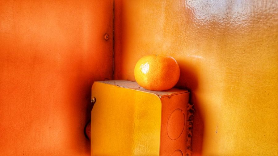 Close-up of orange fruit on yellow box