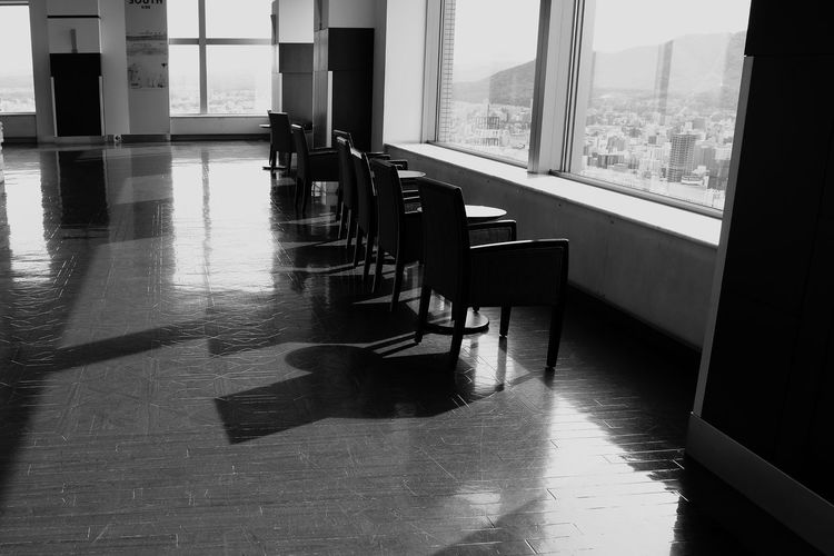Empty table and chairs in room