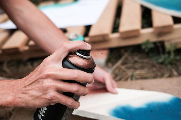 Skateboarding Aerosol Aerosol Can Aerosols Spraying Close-up Day Design Designing Graph Human Body Part Human Hand Paint Sprayer Paint Spraying Painter Painting Painting Art Real People Skateboard Tag