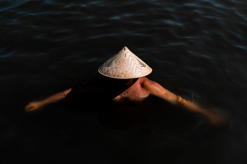Dark Water Water Outdoors Nature People One Person Adults Only Minimal Minimalism Minimalist Swimming The Week On EyeEm View From Above Hat Mix Yourself A Good Time 100 Days Of Summer Done That. Second Acts See The Light Perspectives On People Inner Power This Is Aging Summer Exploratorium Visual Creativity Creative Space The Traveler - 2018 EyeEm Awards