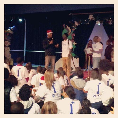 CamNewton surprising kids at big brothers/big sisters Christmas party.