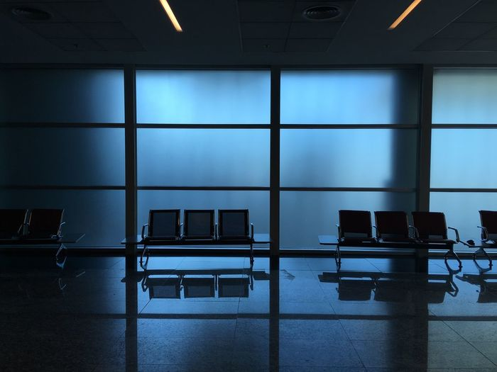 Indoors  Transportation No People Window Airport Architecture Glass - Material Built Structure Blue Airport Departure Area Travel Mode Of Transportation Flooring Day Empty Wall - Building Feature Seat Reflection Air Vehicle Safety