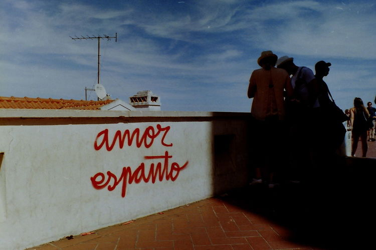 Analogue Photography Lisbon - Portugal Portugal Red Shadowplay Vendors Amor Analog Analog Photography Blue Sky Cloud - Sky Day Horizontal Symmetry Lines And Shapes Lisboa Lisbon Miraduro Outdoors Pentax People Real People Red Letters Sky Summer Text