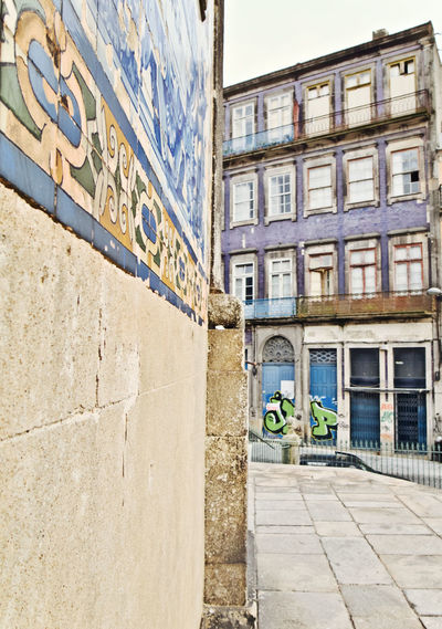 Oporto, Portugal Alley Architecture Building Building Exterior Built Structure City Day Footpath Low Angle View Mode Of Transportation Nature No People Old Outdoors Residential District Road Street Transportation Wall Wall - Building Feature Window