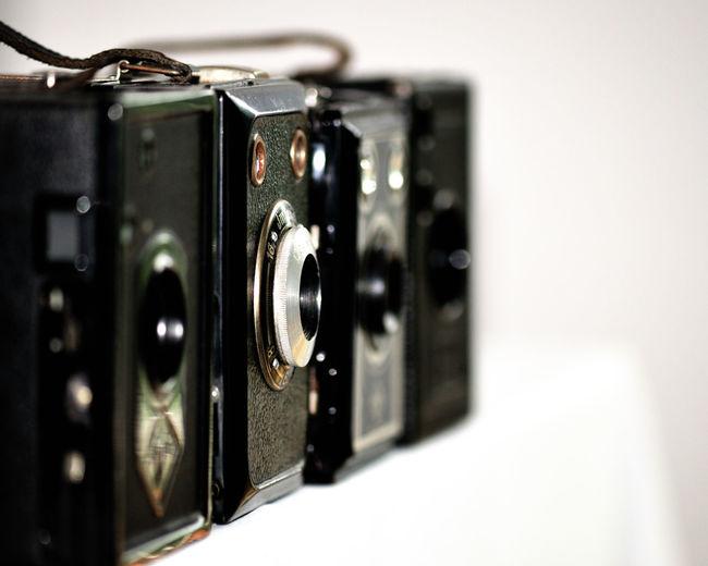 Vintage cameras against white background