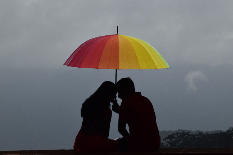 Silhouette Of Man And Woman Under Umbrella