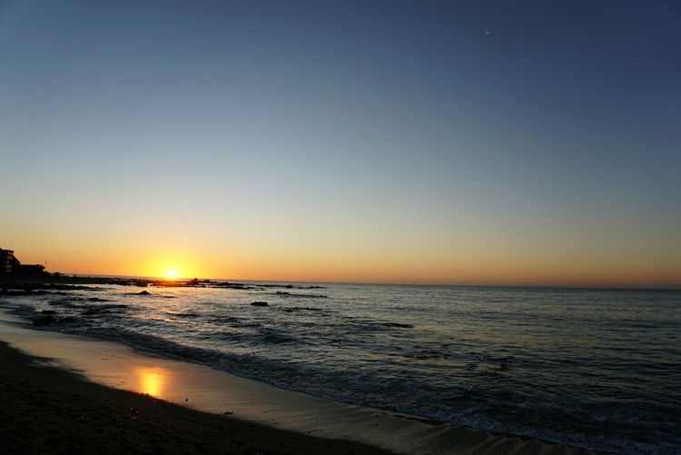 Sea Beach Sunset Sand Horizon Over Water Water Coastline Travel Destinations Scenics Tourism Tranquility Vacations Sun Nature Sky Wave Tranquil Scene Summer Beauty In Nature Dramatic Sky