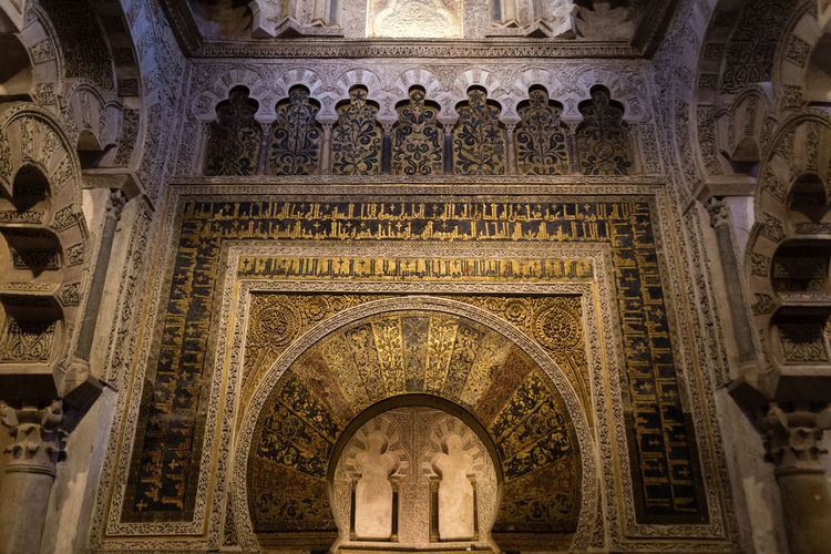 Arch in the historical Mezquita in Cordoba, Spain. Architecture Golden Mezquita Mezquita De Córdoba Moorish Architecture The Week On EyeEm Ancient Architecture Arch Architecture Bas Relief Built Structure Day First Eyeem Photo History Indoors  Indoors  Low Angle View Moorish Religious  Religious Architecture
