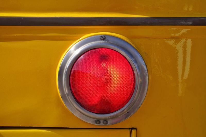 Close-up of a yellow school bus brake light