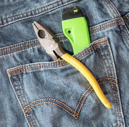 Close-up of work tools in back pocket