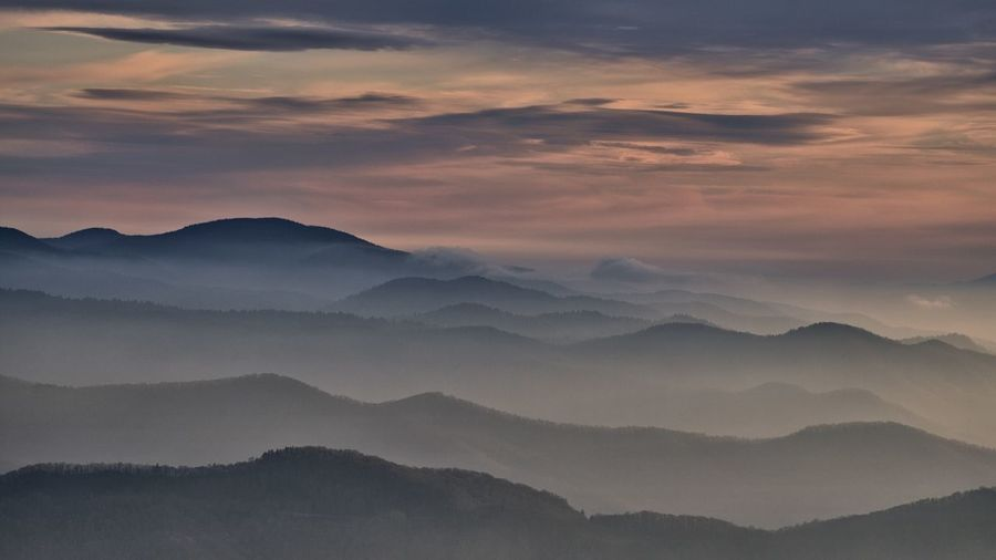 Mountain Scenics - Nature Beauty In Nature Sky Cloud - Sky Tranquil Scene Mountain Range Tranquility Fog Sunset No People Idyllic Non-urban Scene Nature Environment Majestic Outdoors Landscape Silhouette Mountain Peak Hazy  Capture Tomorrow