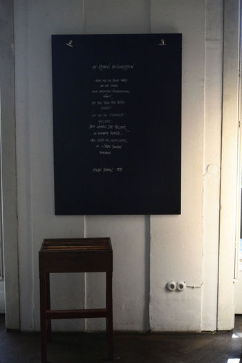 Communication Text Blackboard  Indoors  Board No People Seat Western Script Wall - Building Feature Architecture Table Chair Building Wood - Material Information Empty Built Structure Sign Entrance Absence Menu Message