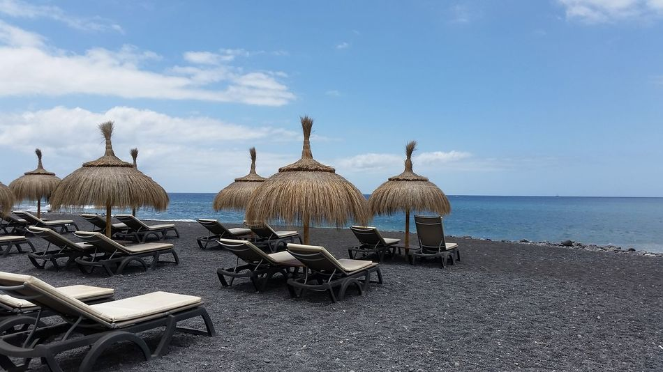 beautiful landscape with horizon over water in front to the atlantic ocean for a row of straw umbrellas with nobody. Order and freshness Atlantic Ocean Freedom Adventure Beach Beauty In Nature Blue Sky Chair Cloud - Sky Day Horizon Over Water Idyllic Land Nature No People Outdoors Sand Scenics - Nature Sea Seat Sky Straw Umbrellas Tenerife Tranquil Scene Tranquility Water