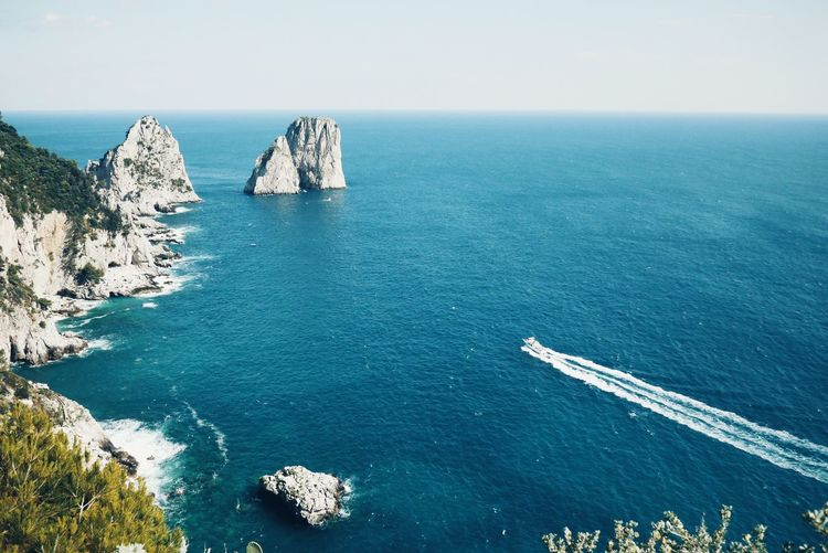 Scenic View Of Rock Formations In Sea At Capri