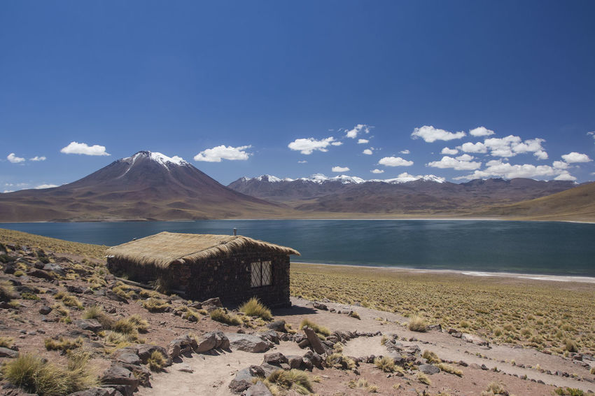 miscanti volcano with snow and its lagoon at andes mountain range with a house Atacama Desert Chile Cloud Miscanti Lagoon Atacama Blue Lagoon Lake Miscanti Mountain Mountain Range Snow Volcano