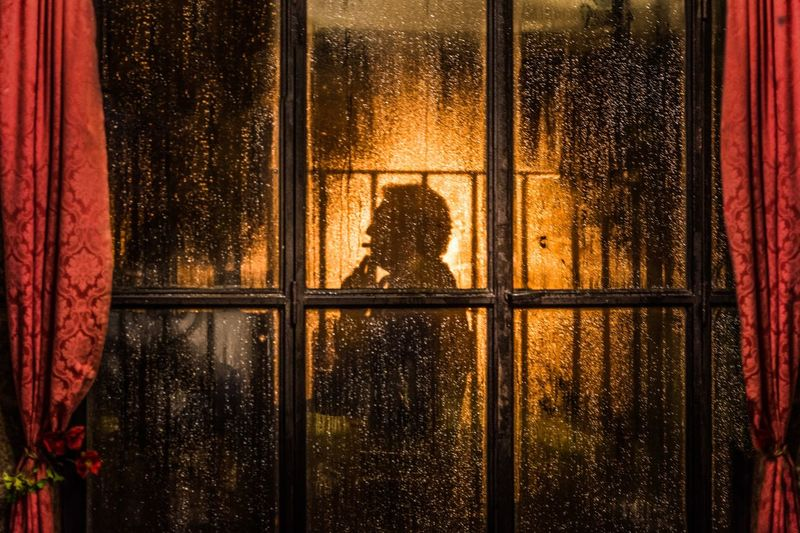 The Street Photographer - 2017 EyeEm Awards Window Night Real People Illuminated Looking Through Window Adult Smoke Silhouette The Week On EyeEm