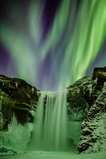 Iceland Skogafoss Aurora Beauty In Nature Scenics - Nature Night Green Color Water Long Exposure Cold Temperature Winter Tranquil Scene Tranquility Nature Idyllic Snow Waterfall Sky Star - Space Astronomy Power In Nature Flowing Water My Best Photo