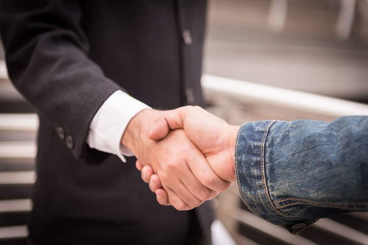 Adult Agreement Body Part Business Business Person Close-up Communication Day Finger Focus On Foreground Hand Handshake Human Body Part Human Hand Males  Men Midsection People Real People Togetherness Two People