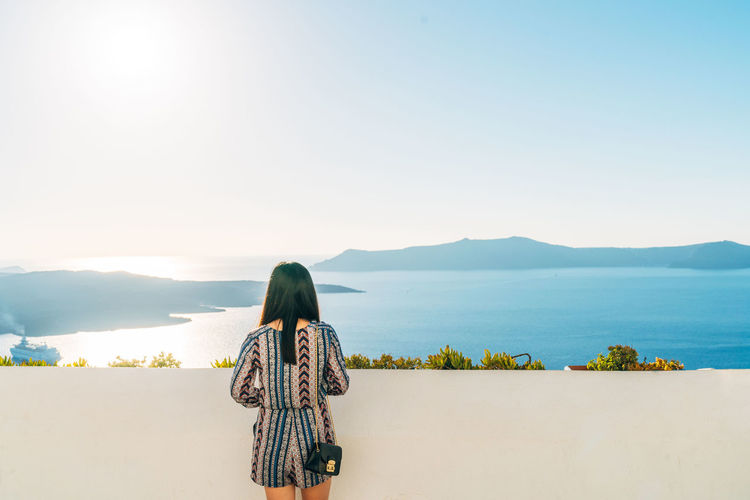 Adult Adults Only Beach Beauty Blue Hiking Landscape Mountain Mountain Range Nature One Person One Woman Only Only Women Outdoors People Rear View Santorini Scenics Sea Sky Summer Tranquility Travel Destinations Women Young Adult The Great Outdoors - 2018 EyeEm Awards