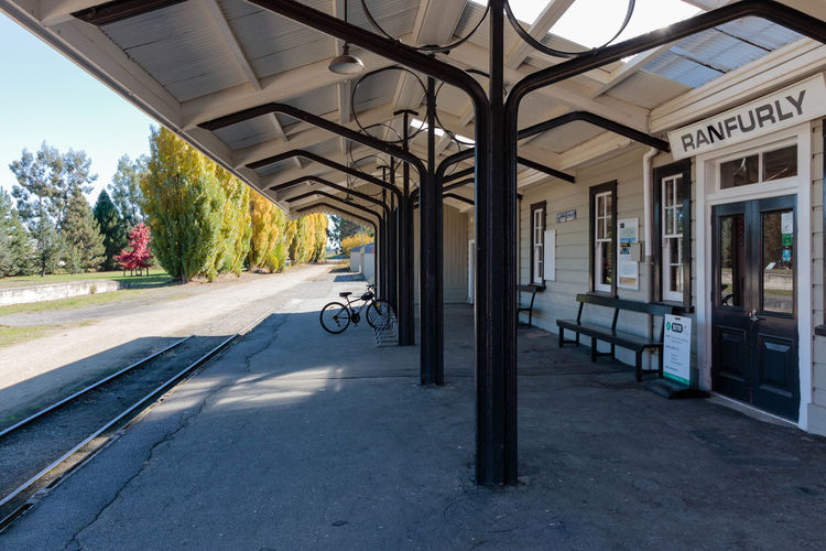 Ranfurly Station, built in 1898, was the line's main crew and engine change-over station. As recently as 1983 it had a Stationmaster, Office Assistant, Traffic Operator (Shunter), Train Examiner, Inspector Permanent way and his assistant, a Track Gang and a Bridge Gang. https://www.otagocentralrailtrail.co.nz/things-to-see-and-do/railway-heritage/#ranfurly-station The line remained open for some time longer than most other branch lines in the South Island, and was used to move construction materials for the Clyde Dam project. With the completion of the dam in 1990, there was little other traffic for the line and the line was closed by the New Zealand Railways Corporation on 30 April 1990. The demolition of the line from Clyde back to Middlemarch commenced on 8 December 1990 and was completed on 5 December 1991. Part of the section closest to Dunedin and to Middlemarch became a tourist railway, operated by Dunedin Railways. The remainder of the line was lifted and the trackbed developed into the Otago Central Rail Trail. https://en.wikipedia.org/wiki/Otago_Central_Railway Transportation Built Structure Architecture Sunlight Tree Ranfurly New Zealand Railway Station EyeEm EyeEm Selects