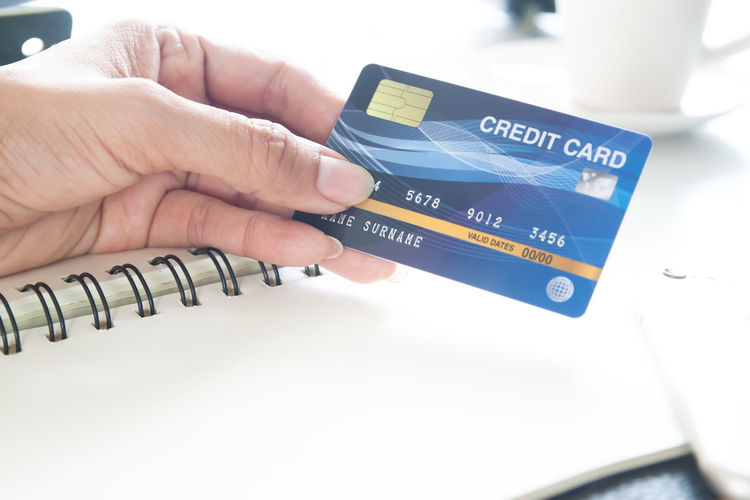 Hand holding plastic credit card. E-payment, technology and online shopping concept Passport Tax Insurance Notebook Female Resort Blue People Bank Buying Design Holding Computer Using Laptop Consumerism Commerce Electronic Sale Account Identity Number Customer  Job Worker Buy Holiday Plastic Transaction Store Finance Pay Money Travel Concept Purchase Online  Payment Technology Paying Banking Cards Business Woman Background Shopping Wallet Card Credit