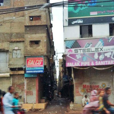 Karachi rains and the man in the middle Karachi Pakistan Aimanadeel Streetphotography Photographerslifeforme Rain Raining RainyDay Pouring RainyDays Water Clouds Cloudy Photooftheday Puddle Umbrella Instagood Gloomy Rainyweather Rainydayz Splash Downpour Instarain