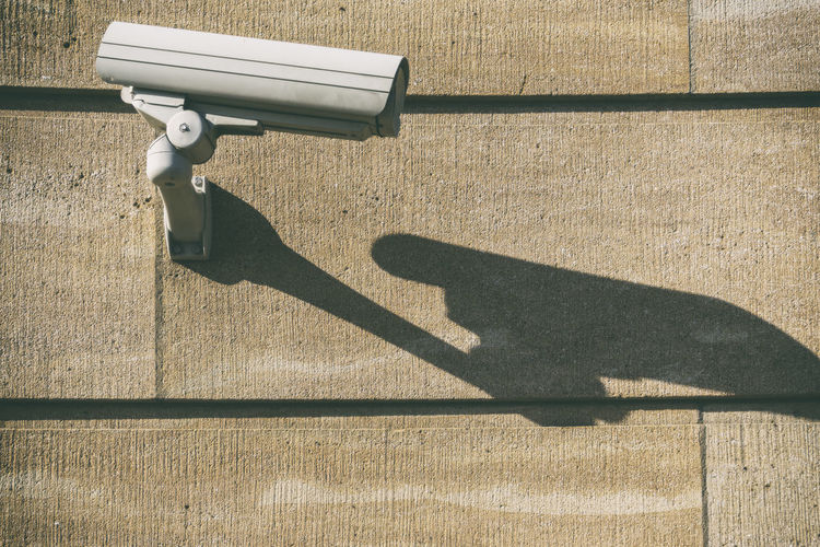 Shadow Of Security Camera On Wall