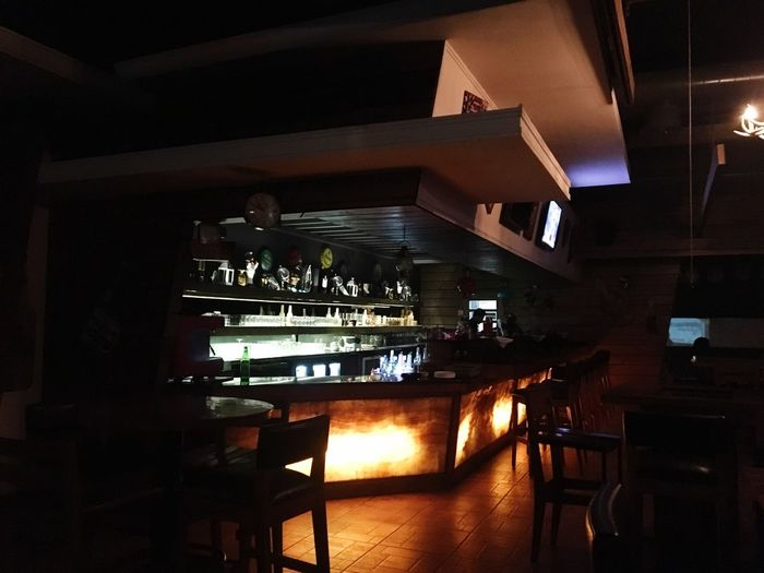 Silent bar Illuminated Table Indoors  Business Restaurant Architecture Bar - Drink Establishment No People Night Bar Counter Food And Drink Seat Built Structure Flooring Chair Reflection Lighting Equipment High Angle View Adventures In The City