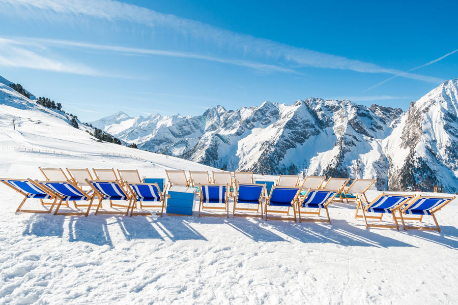 Empty blue deck chairs on the snow in Mayrhofen ski resort, Austrian Alp Alps Alps Austria Blue Chairs Colors Deck Chairs Frost Glacier Mayrhofen Mountains No People Relaxing Resprt S Scenics Ski Resort  Ski Resort Hotel Skiing Snow Sunny Day