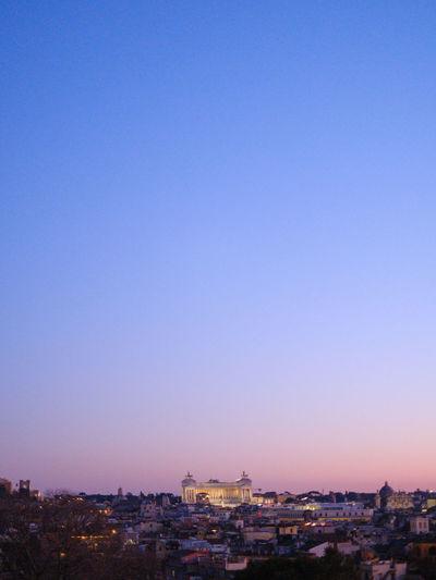 Cityscape against clear sky at dusk