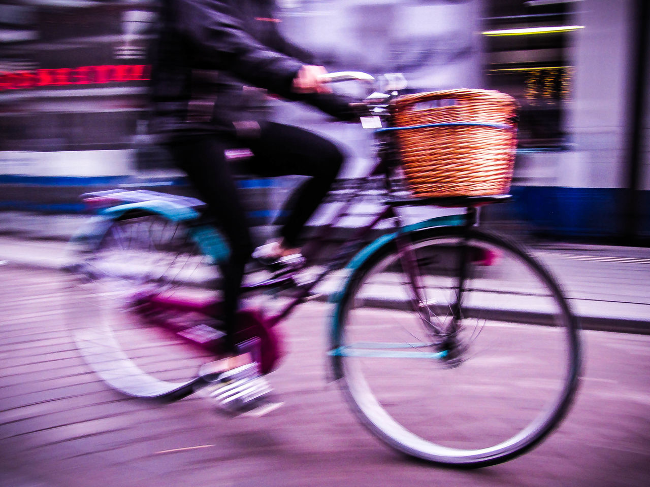 bicycle, blurred motion, transportation, mode of transport, street, cycling, real people, motion, riding, speed, outdoors, side view, land vehicle, one person, day, city, low section, men, people