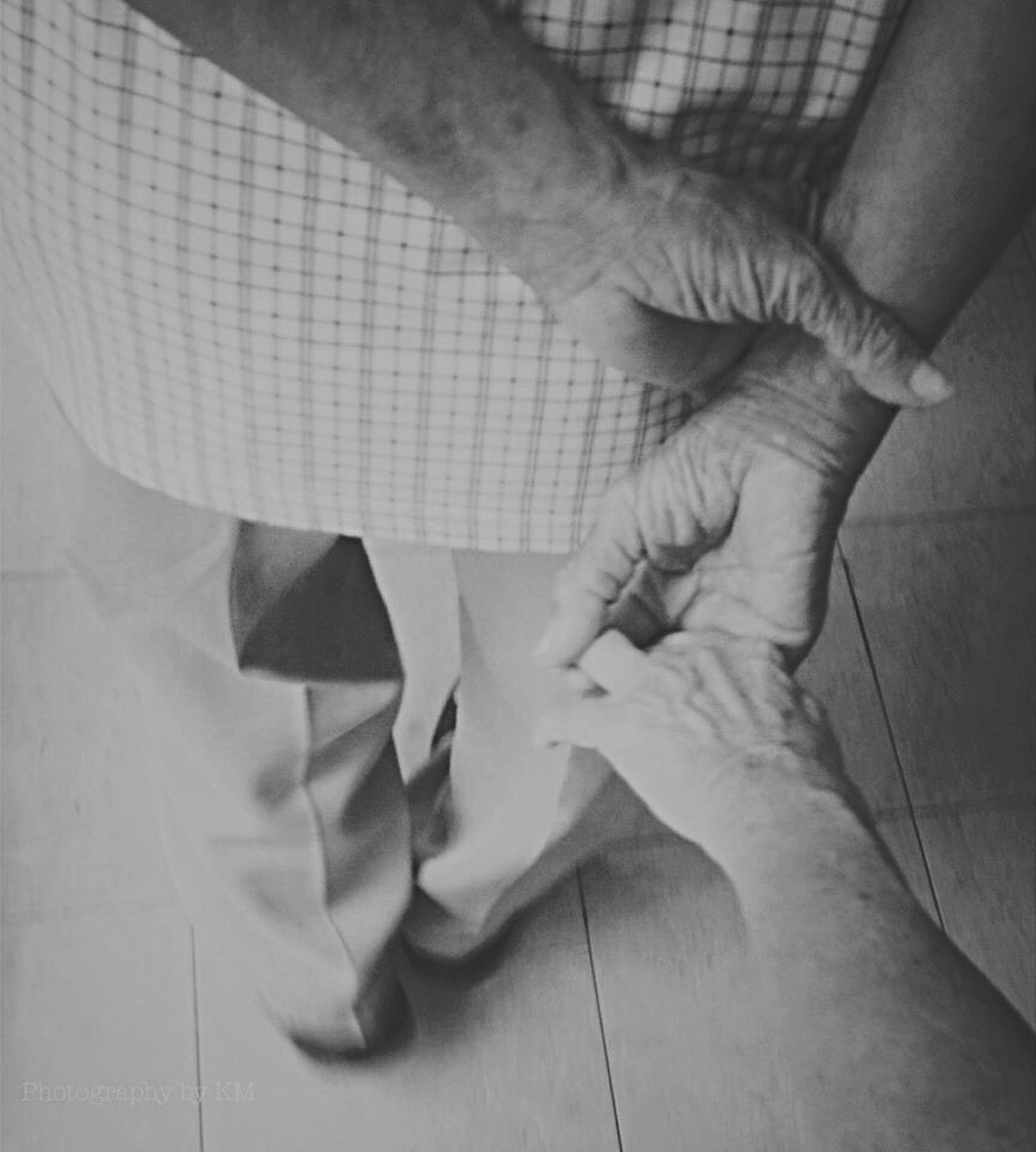 indoors, person, lifestyles, part of, leisure activity, low section, barefoot, cropped, men, human finger, human foot, high angle view, close-up, unknown gender