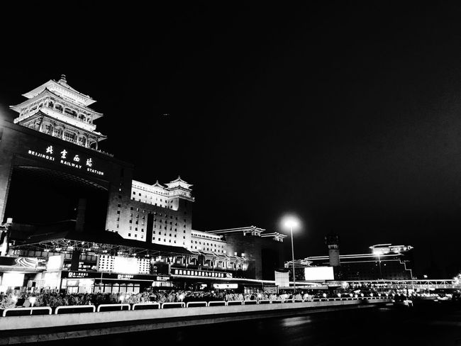 Beijing West Railway Station In The Evening Night Architecture Building Exterior Illuminated Built Structure Copy Space Outdoors Clear Sky Travel Destinations Sky Real People Low Angle View Large Group Of People City People Architecture Black And White City IPhone Photography Monochrome BEIJING北京CHINA中国BEAUTY Monochrome Photography