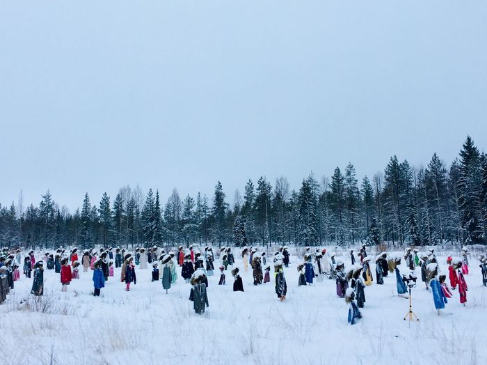 Group Of People On Snow Covered Landscape