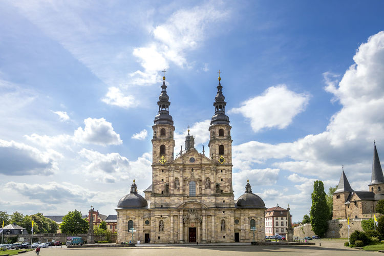 Historic church against cloudy sky