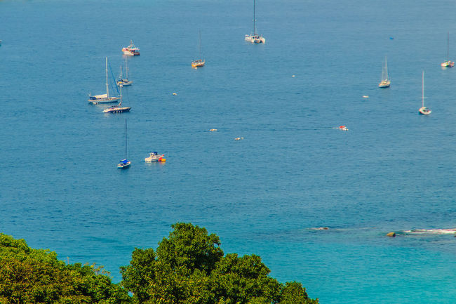 Tropical beach seascape panorama view with boats and yatchs. Beautiful turquoise ocean waives with boats and sandy coastline from high view point. Kata and Karon beaches, Phuket, Thailand Aerial Seascape Coastline Coastline Landscape Coastline Nature Water Karon Beach, Phuket Karon Beach, Phuket, Thailand Kata Beach Kata Beach,Phuket Thailand Phuket,Thailand Seascape Photography Aerial Landscape Aerial View Beauty In Nature Blue Boats Coastline Beauty Coastline Sky Day High Angle View Karon Karon Beach Karon View Point Kata Noi Beach Nature Nautical Vessel No People Outdoors Scenics Sea Seascape Seascape Skyscape Sky Tranquility Transportation Tree Turquoise Sea Water Waterfront Yatch Marine Yatching