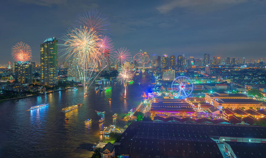 Fireworks at Asiatique The Riverfront, Bangkok, Thailand Asiatique The Riverfront Bangkok Cityscape Downtown Financial District  Fireworks New Year Thailand Architecture Building Exterior Buildings Built Structure Celebration Chao Praya River City Cityscape Firework Display Illuminated Modern Multi Colored Night No People Outdoors Sky Skyscraper Travel Destinations Urban Skyline Water