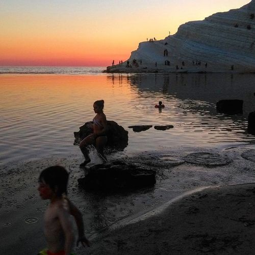 Beach Sunset Sea People Reflection Water Two People Full Length Silhouette Boys Adult Child Sand Outdoors Landscape Men Tranquility Children Only Standing Males  Scaladeiturchi Sicilia Agrigento Sicily