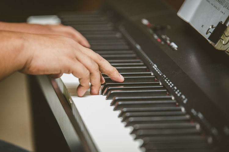 Selective focus of Man hand playing piano Adult Art Artist Black Button Chord Classic Classical Closeup Concert Entertainment Finger Guy Hand Human Instrument Jazz Key Keyboard Macro Male Man Melody Men Music Musical Musician Note Old One People Performance Performer  person Pianist Piano Play Player Practicing Rhythm Row Song Sound Vertical White