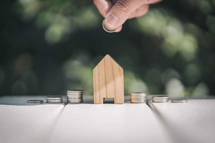 Saving to buy a house or home savings concept with money coin stack growing.Saving money concept. Loan  Stack Coin Home Interior Saving Money Wealthy