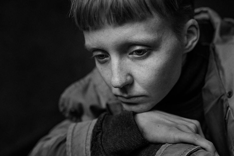 Close-up of depressed woman in darkroom