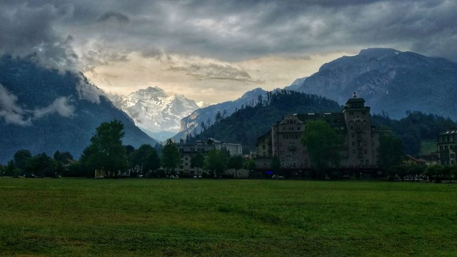 Before the Storm Eye4photography  Berner Oberland Bernese Oberland cityscapes Baellehoechscht Jungfrau Interlaken Thunderstorm Before The Storm Mountain Snow City Sky Grass Landscape Mountain Range Architecture Cloud - Sky Mountain Peak Snowcapped Mountain
