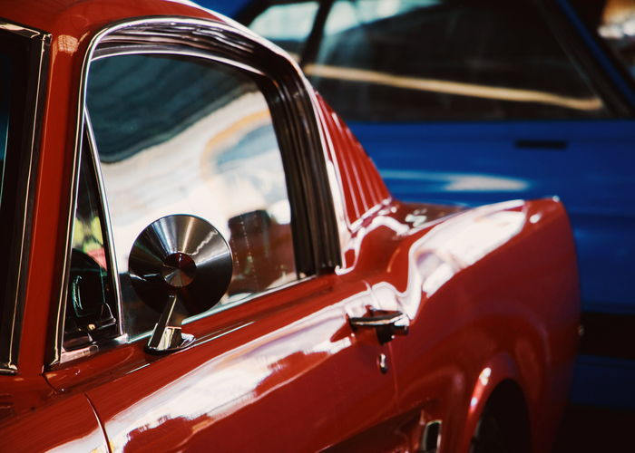 Close-up of vintage car on side-view mirror